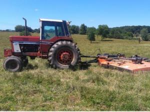 Tractor and rotary brush mower.